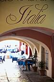 Arcade at the harbour, Lago di Garda, Malcesine, Veneto, Italy