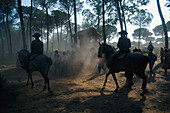Pilgrims travelling afoot and on horseback on the sandy Raya Real, Andalusia, Spain