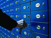 Man opening a safe deposit box in a Bank, Business