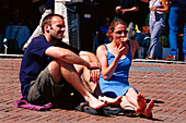 Young couple at Piazza del Campo, Siena Tuscany, Italy