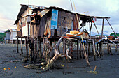 Pile dwelling on the beach at low tide, Port of Quepos, Costa Rica, Central America, America