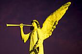 Illuminated angel statue in front of church, Sarchi, Costa Rica, Central America, America