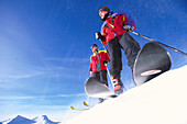 Skier, Two skiers on mountain top, Siala, Laax, Grisons, Switzerland