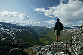 Hiker looking at the view from Dalsnibba, More og Romsdal, Norway