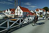 Mother and child on a bike, Torvet, Risor, Aust Augder, Norway