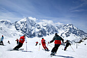 Group of Skiers on the slope, Ortler mountain range in the background, Sulden, Madritsch, South Tyrol, Italy