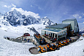 Skiers having a break on the terrace at the Upper Station, Sulden, South Tyrol, Italy
