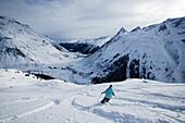 Person skiing in powder snow, Free Skiing, Ballunspitze, Wirl near Galtuer, Tyrol, Austria