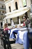 Family enjoying a meal, Markus Square, Zakynthos, Zakynthos Island, Ionian Islands, Greece