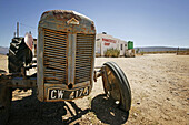 Old Tractor in front of Ronnies Sex Shop, Route 62, Little Karoo, Western Cape, South Africa