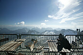 Man lunching in refuge on mountain top, Zugspitze, Bavaria