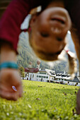 Girl playing on meadow, Girl playing on meadow, St.Bartholomae, Koenigssee, Berchtesgaden, Bavaria, Maedchen, kopfueber, auf Wiese bei St.Bartholomae, Koenigssee, Berchtesgaden, Bayern, Deutschland