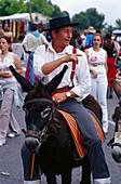 Pilgrim riding a donkey, Romeria de San Isidro, Nerja, Costa del Sol, Malaga province, Andalusia, Spain, Europe