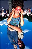 Woman held upside down, Berlin, Deutschland