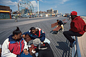 Youths at an amusement park on Coney Island, New York City, New York, USA