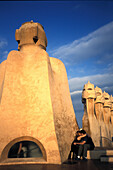 Kissing couple on the roof of the Casa Mila, Barcelona, Spain, Europe