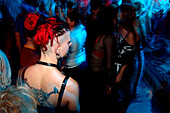 Young woman with tatoo, punk, in the disco, Nightlife, Berlin, Germany