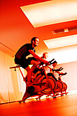 Spinning, Men and woman in gym on exercise bikes, Spinning, leos Sports Club Muenchen