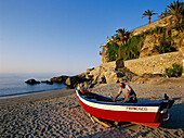 Fisherman at Playa de Calahonda beside Balcon de Europa, Nerja, Costa del Sol, Province of Mlaga, Andalusia, Spain