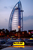 View at taxis and the hotel Burj al Arab in the evening, Dubai, United Arab Emirates, Middle East, Asia