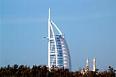 View at minarets and the Burj al Arab hotel, Dubai, United Arab Emirates, Middle East, Asia