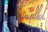 Dark alley with sign, ghent, belgium