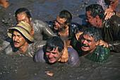 A group of men in the water, The Pond Holiday, El Charco, San Nicolas de Tolentino, Gran Canaria, Canary Islands, Spain