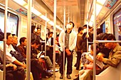 Chinese people in the subway in the evening, Shanghai, China, Asia