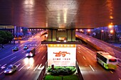 Illuminated advertisement and highway with cars in the evening, Shanghai, China, Asia