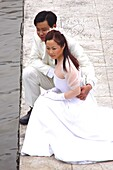 Bridal couple posing at the river bank, Shanghai, China, Asia