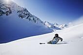 Person snowboarding in fresh snow, Gaiskogel, Kuehtai, Tyrol, Austria