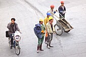 High angle view at workers and cyclist, Shanghai, China, Asia