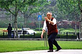 Old man doing gymnasics in the park, Shanghai, China, Asia