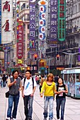 Young people at the pedestrian zone, Shanghai, China, Asia