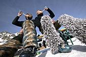 Snowboarders drinking and celebrating, Apres Ski, Soelden, Oetztal, Austria