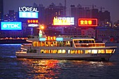 Illuminated excursion boat on the river in the evening, Shanghai, China, Asia