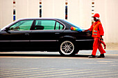 Worker cleaning a car, Dubai, UAE, United Arab Emirates, Middle East, Asia