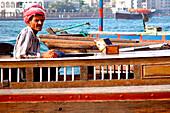 Arab in a traditional boat, Abra, Dubai Creek, Dubai, UAE, United Arab Emirates, Middle East, Asia