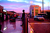 People in front of the airport in the evening, Dubai International Airport, Dubai, UAE, United Arab Emirates, Middle East, Asia