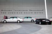 Luxury cars in front ofJumeirah Beach Hotel, Dubai, UAE, United Arab Emirates, Middle East, Asia