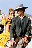 Couple on horseback, Feria de Abril, Sevilla, Seville, Andalusia, Spain