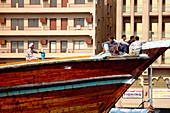 Sailors on a boat in Dubai Creek, Dubai, United Arab Emirates, UAE