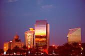 Illuminated high rise buildings in the evening, Deira, Dubai, UAE, United Arab Emirates, Middle East, Asia