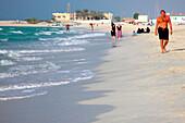People strolling along the beach, Dubai, UAE, United Arab Emirates, Middle East, Asia