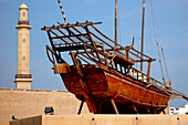 Old ship at Dubai museum and minaret in the sunlight, Dubai, UAE, United Arab Emirates, Middle East, Asia