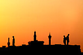 Silhouettes of people and minarets in the afterglow, Dubai Creek, Dubai, UAE, United Arab Emirates, Middle East, Asia