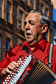Old musician with accordion, St. Peter Port, Guernsey, Channel Islands, UK