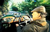 Man driving an Aston Martin, Jersey, Channel Islands, Great Britain