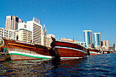 Dhow boats on Dubai Creek in front of modern high rise buildings, Dubai, UAE, United Arab Emirates, Middle East, Asia