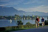 Two cyclists, Chiemsee, Fraueninsel, Chiemgau, Bavaria, Germany